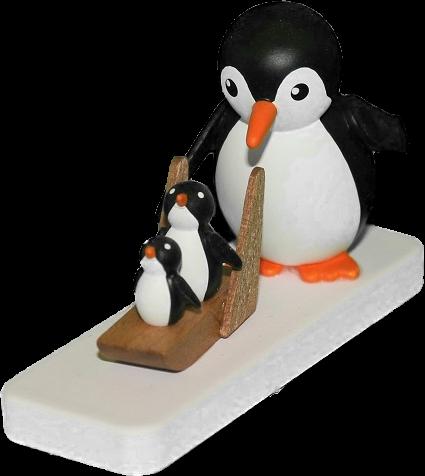 Pinguin mit kleinem Schlittenfahrer